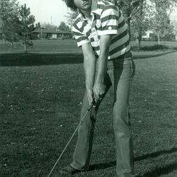 A denim-wearing Jay Don Blake stands over his ball. Forty years ago the Utah State golfer won medalist honors at the NCAA Championship.