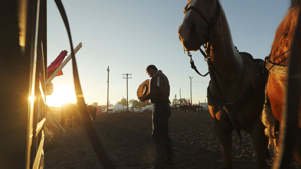 Steer wrestler Blake Knowles stands for the national anthem during the Magic Valley Stampede PRCA Rodeo at the Twin Falls County Fair in Filer, Idaho, on Thursday Sept 3, 2020.