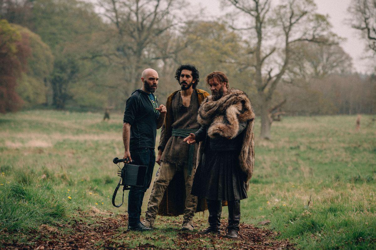 David Lowery, Dev Patel, and Joel Edgerton on the set of The Green Knight