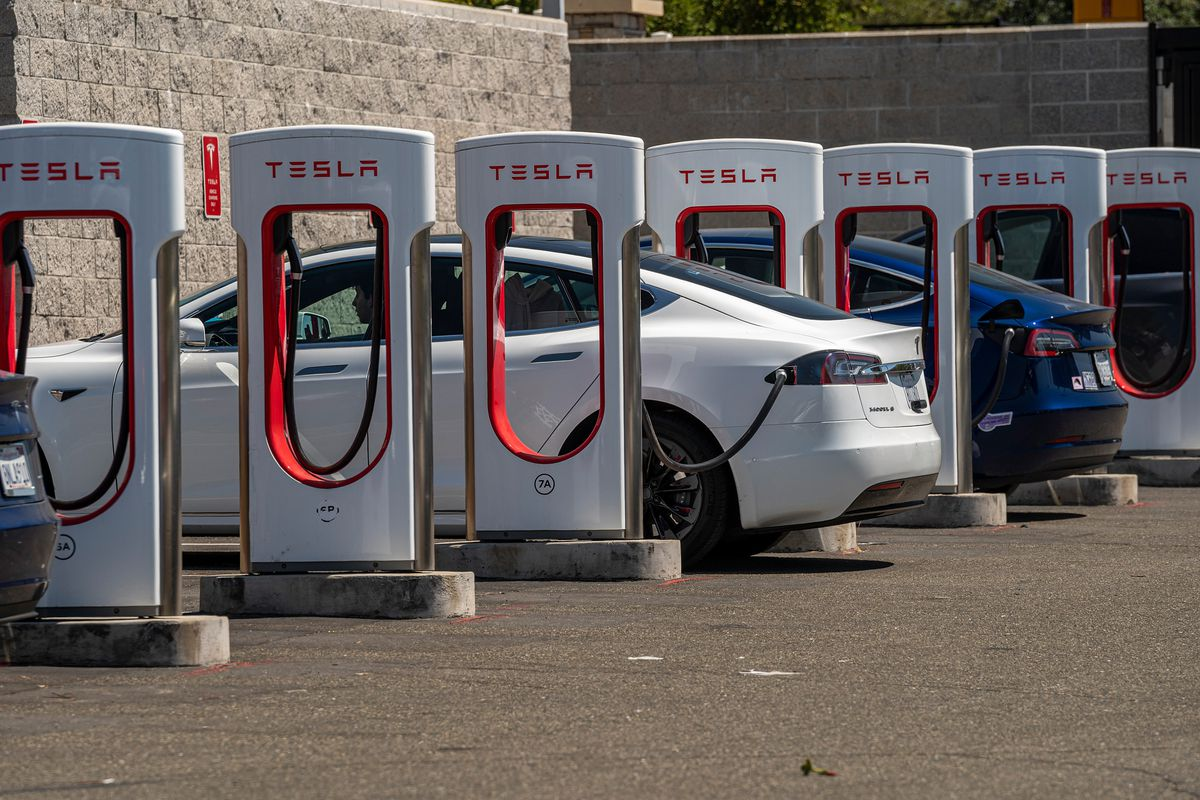 A Tesla Charging Station And Store Ahead Of Earnings Figures