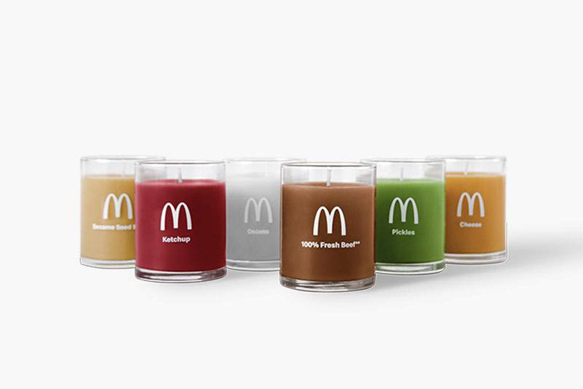 Six candles in glass jars featuring the McDonald's logo
