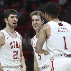 Utah Utes forward Riley Battin (21) and Utah Utes guard Jaxon Brenchley (5) laugh after a foul during a game against the Oregon State Beavers in Salt Lake City on Thursday, Jan. 2, 2020. Utah won 81-69.