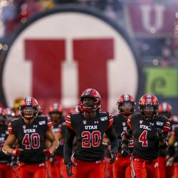 Utah Utes linebacker Devin Lloyd (20) leads the Utes onto the field before the start of an NCAA football game against the Arizona State Sun Devils at Rice-Eccles Stadium in Salt Lake City on Saturday, Oct. 19, 2019.