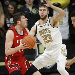 Utah forward Riley Battin, left, prepares to go for a basket as Colorado forward Lucas Siewert and guard Maddox Daniels defend in the second half of an NCAA college basketball game Sunday, Jan. 12, 2020, in Boulder, Colo.