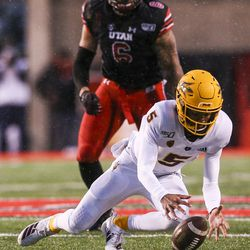 Arizona State Sun Devils quarterback Jayden Daniels (5) lands on a wild snap during the second half of an NCAA football game at Rice-Eccles Stadium in Salt Lake City on Saturday, Oct. 19, 2019.