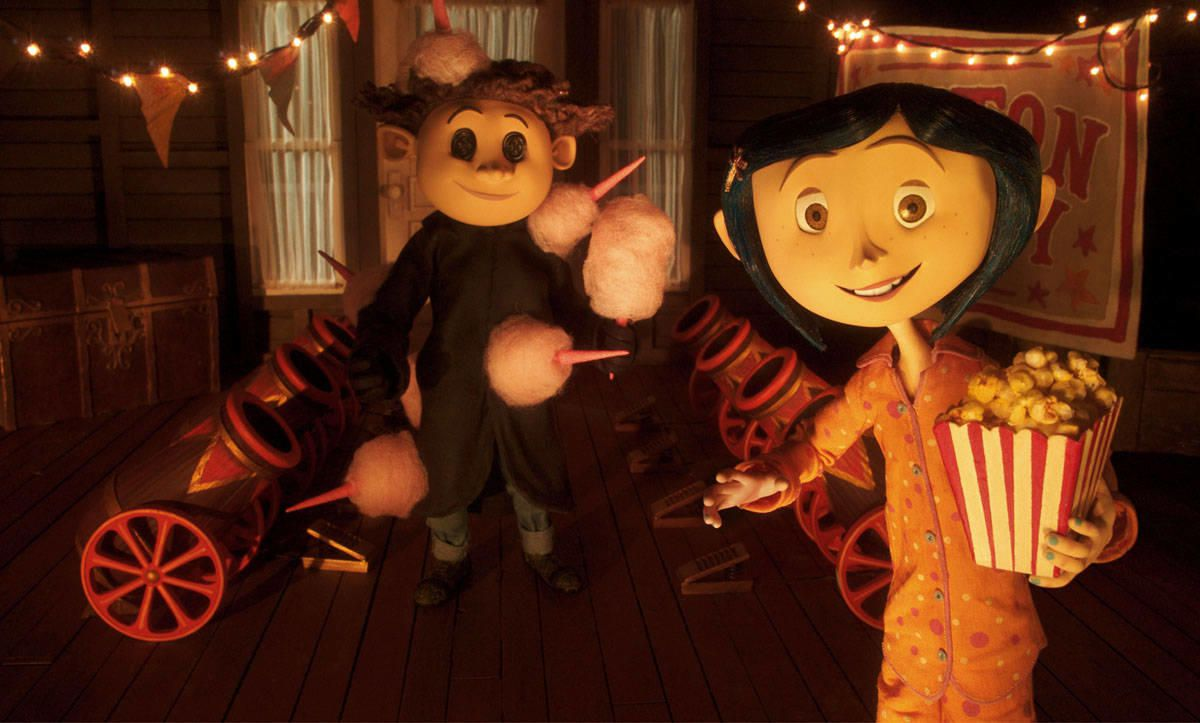 In the Other World, Wybie (voiced by Robert Bailey Jr.) and Coraline (voiced by Dakota Fanning) are drawn to a circus.