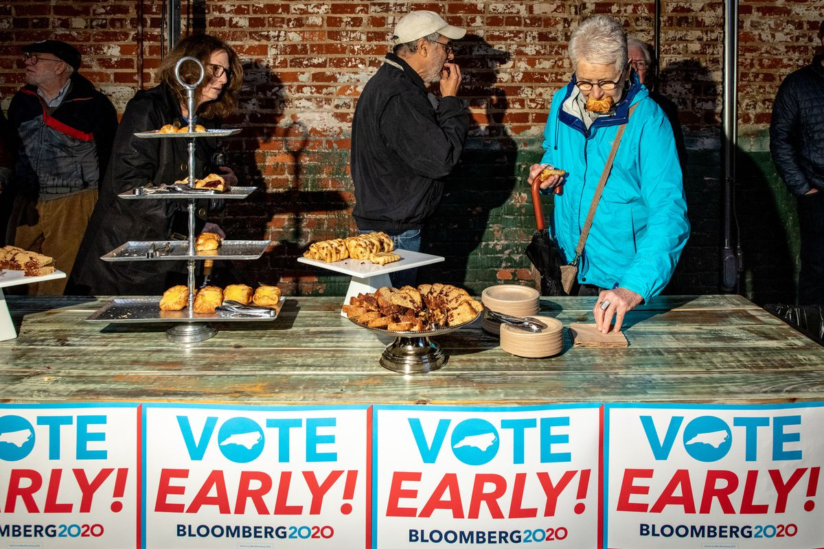 Voters eat pastries at a Bloomberg campaign event.