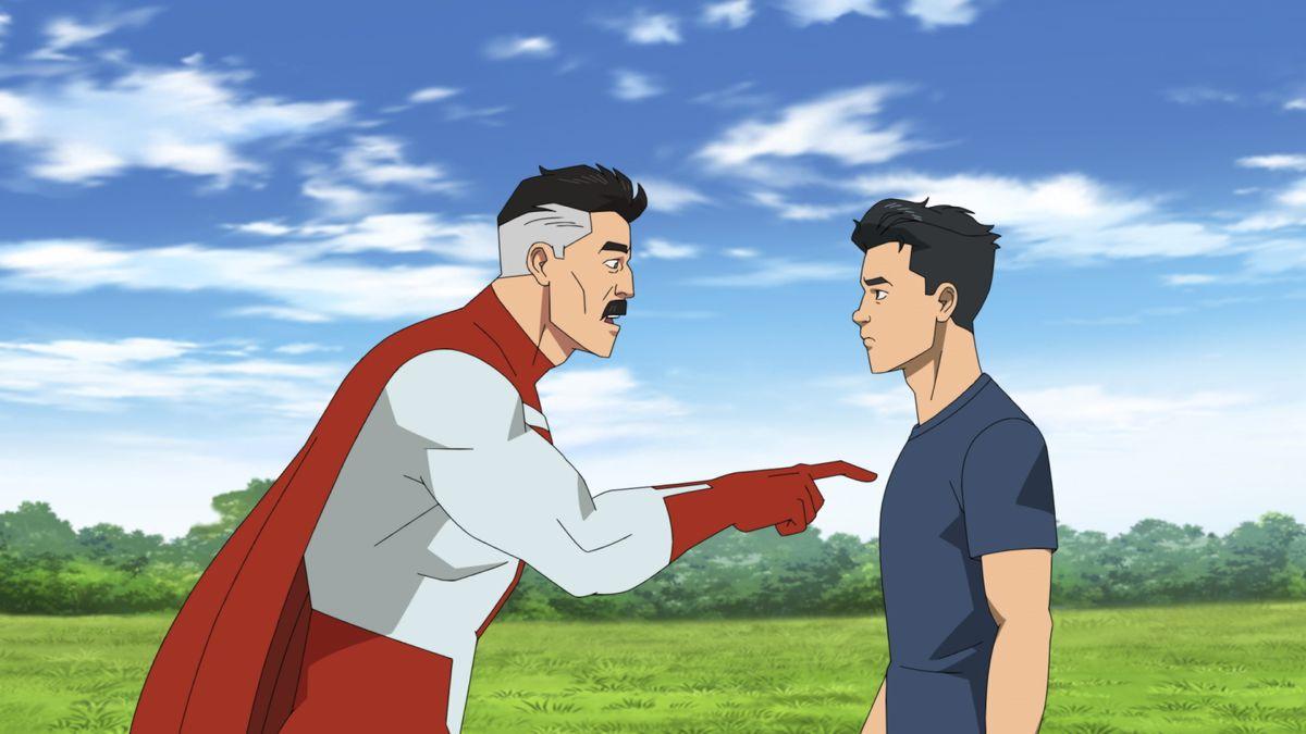 Omni-Man pokes his son Invincible in the chest