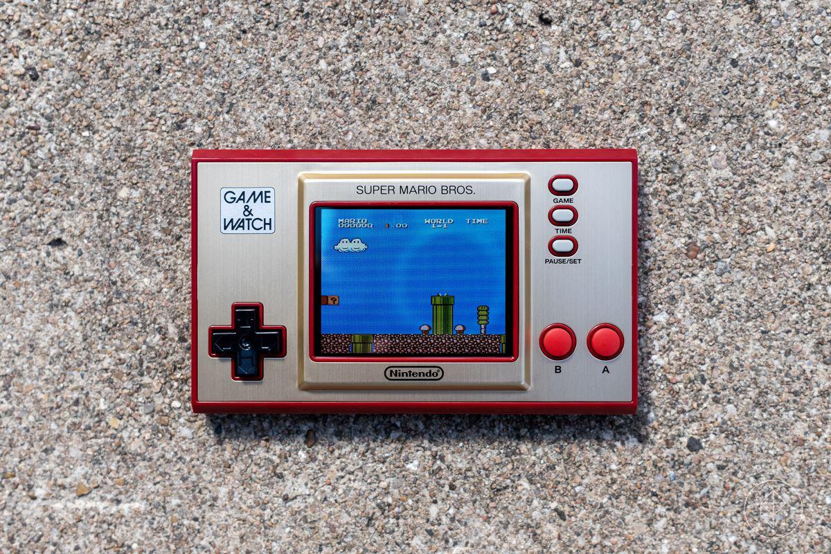 A Nintendo Game & Watch: Super Mario Bros. console photographed on concrete