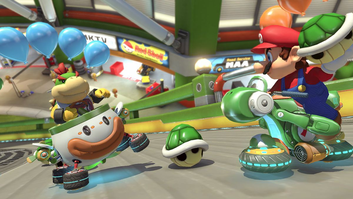 Mario aiming a green shell at Bowser Jr. in Mario Kart 8 Deluxe