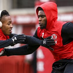 Utah Utes defensive backs Jaylon Johnson, right, and Tareke Lewis warm up before the start of an NCAA football game between the Utah Utes and Arizona State Sun Devils at Rice-Eccles Stadium in Salt Lake City on Saturday, Oct. 19, 2019.