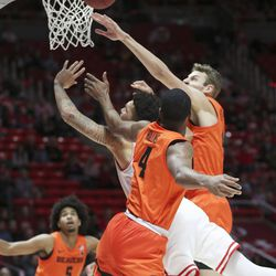 Utah Utes forward Timmy Allen (1) drives on Oregon State Beavers forward Alfred Hollins (4) in Salt Lake City on Thursday, Jan. 2, 2020.