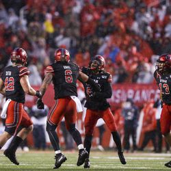 The Utah Utes celebrate during the second half of an NCAA football game at Rice-Eccles Stadium in Salt Lake City on Saturday, Oct. 19, 2019.