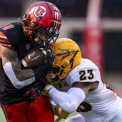 Utah Utes wide receiver Derrick Vickers (8) is hit by Arizona State Sun Devils linebacker Tyler Whiley (23) on a running play during the first half of an NCAA football game at Rice-Eccles Stadium in Salt Lake City on Saturday, Oct. 19, 2019.