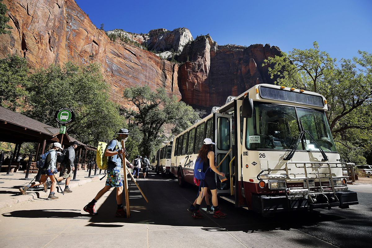 Visitors board a shuttle at Zion National Park on Wednesday, Oct. 14, 2020.