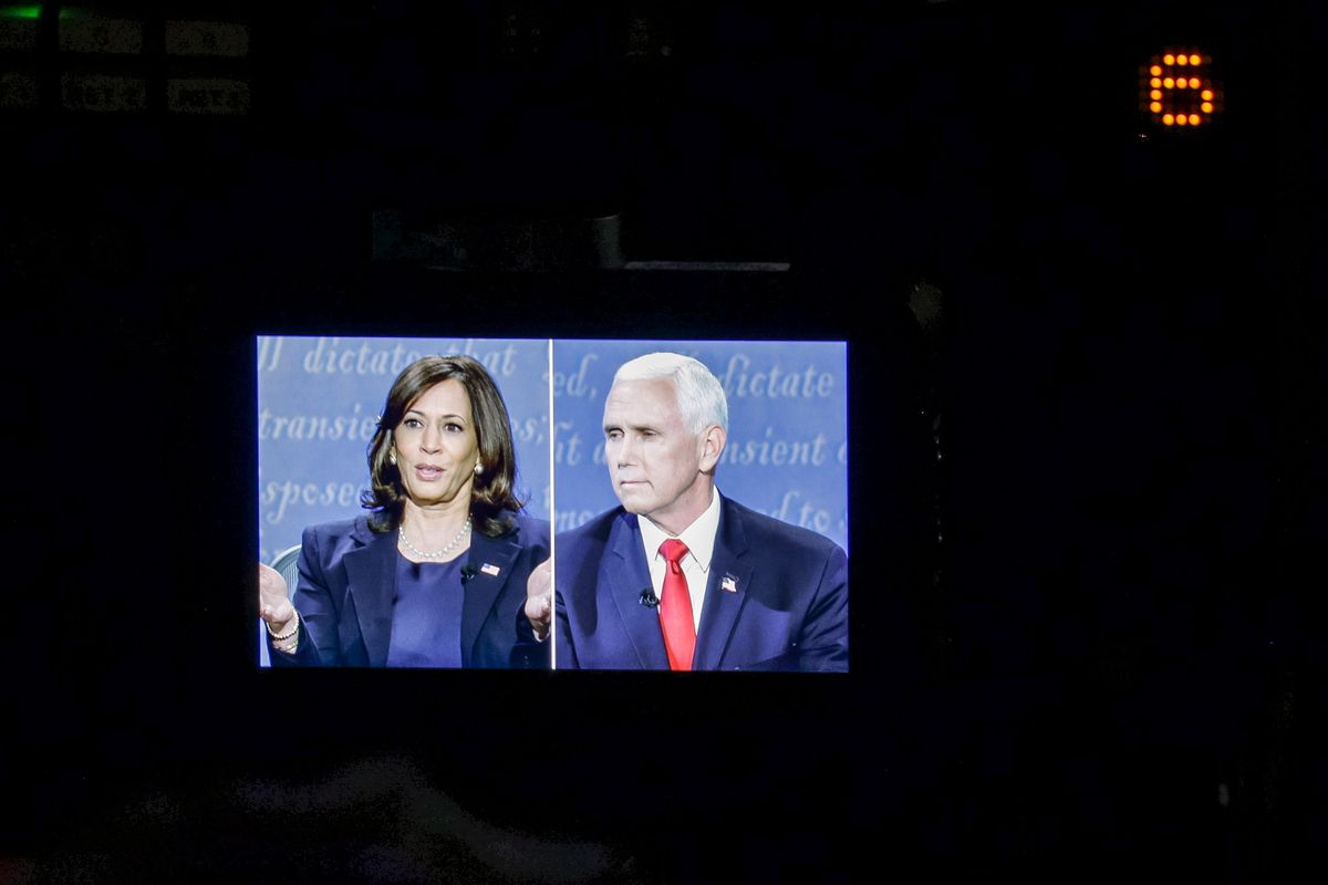 Democratic vice presidential candidate California Sen. Kamala Harris and Vice President Mike Pence are seen on a television monitor during the vice presidential debate at Kingsbury Hall at the University of Utah in Salt Lake City on Wednesday, Oct. 7, 2020.