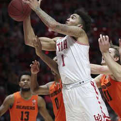 Utah Utes forward Timmy Allen (1) is fouled driving to the basket in Salt Lake City on Thursday, Jan. 2, 2020.