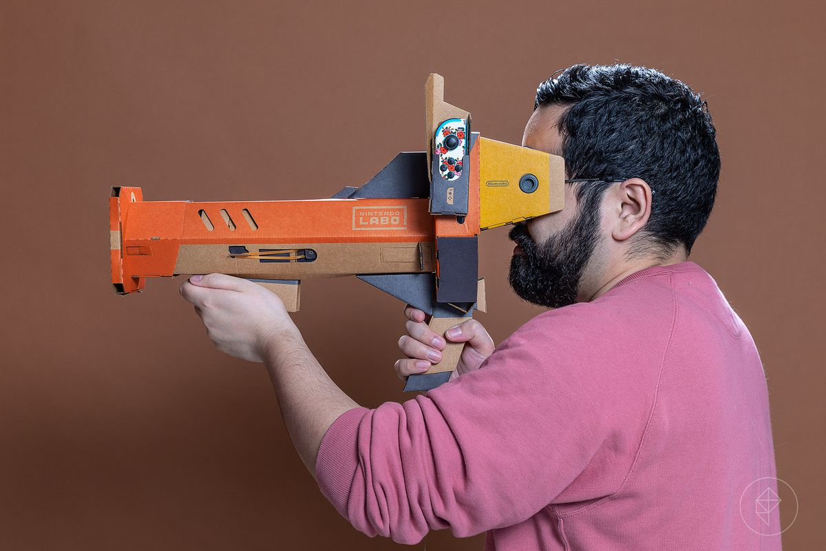 Nintendo Labo VR Kit - profile view of Jeff holding Blaster Toy-Con