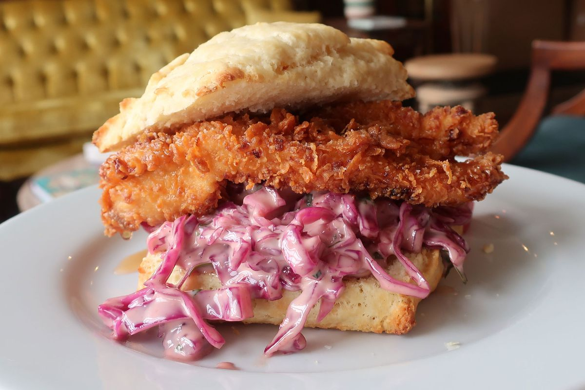 Fried chicken sandwich with cole slaw sits on a plate at the Baker's Table