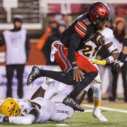Utah Utes quarterback Jason Shelley (15) hurdles Arizona State Sun Devils linebacker Darien Butler (37) during the second half of an NCAA football game at Rice-Eccles Stadium in Salt Lake City on Saturday, Oct. 19, 2019.