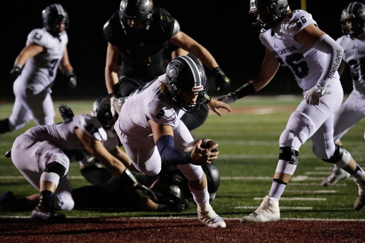 Corner Canyon's Jaxson Dart (2) carries the ball into the end zone for a touchdown during a high school football game at Lone Peak High School in Highland on Thursday, Sept. 24, 2020.