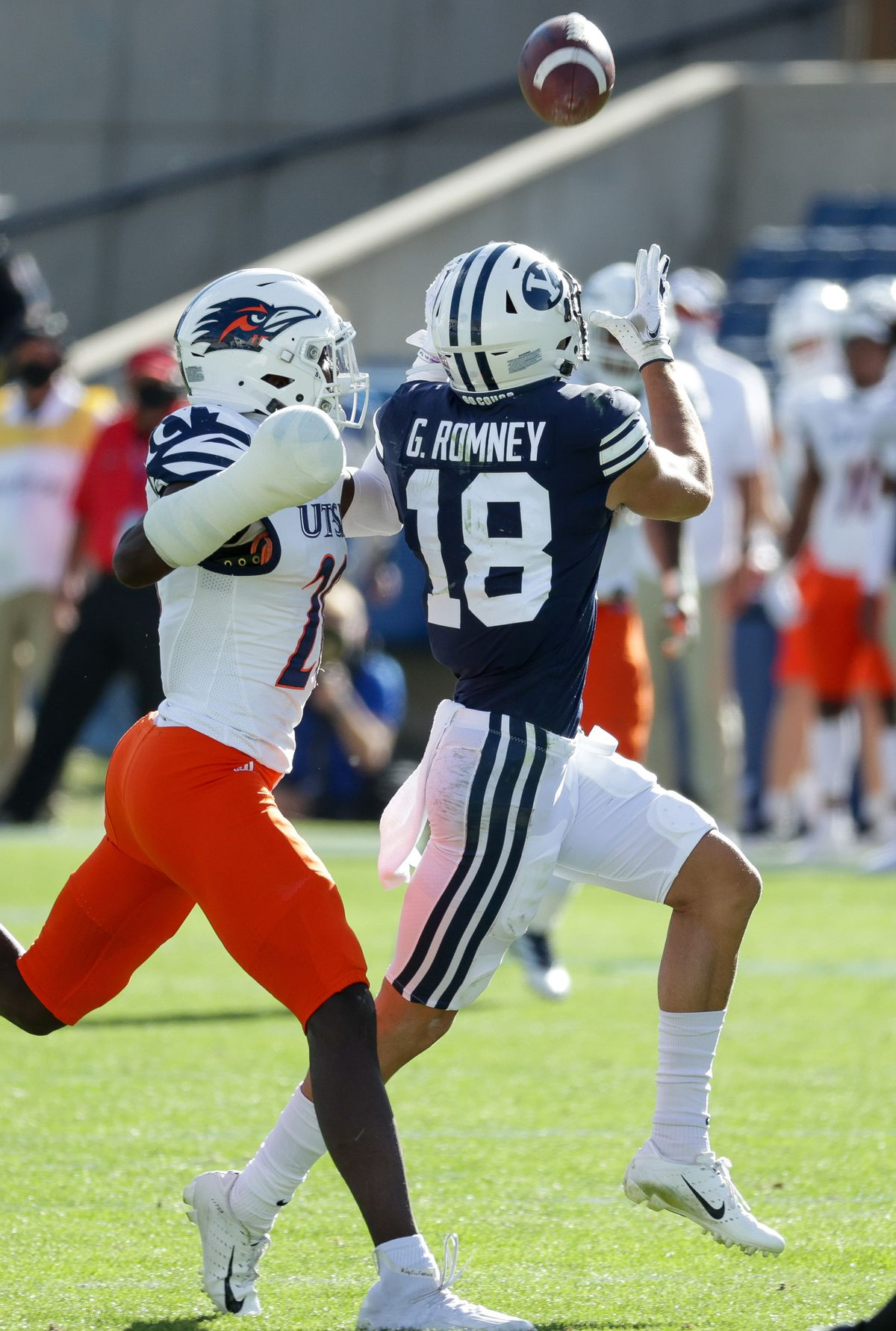 Brigham Young Cougars wide receiver Gunner Romney (18) pulls in a pass under pressure from UTSA Roadrunners cornerback Tariq Woolen (20) at LaVell Edwards Stadium in Provo on Saturday, Oct. 10, 2020.