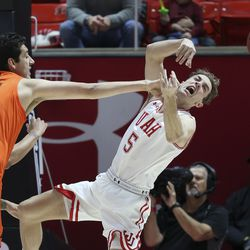 Utah Utes guard Jaxon Brenchley (5) tries to track down a rebound on Oregon State Beavers center Roman Silva (12) in Salt Lake City on Thursday, Jan. 2, 2020.