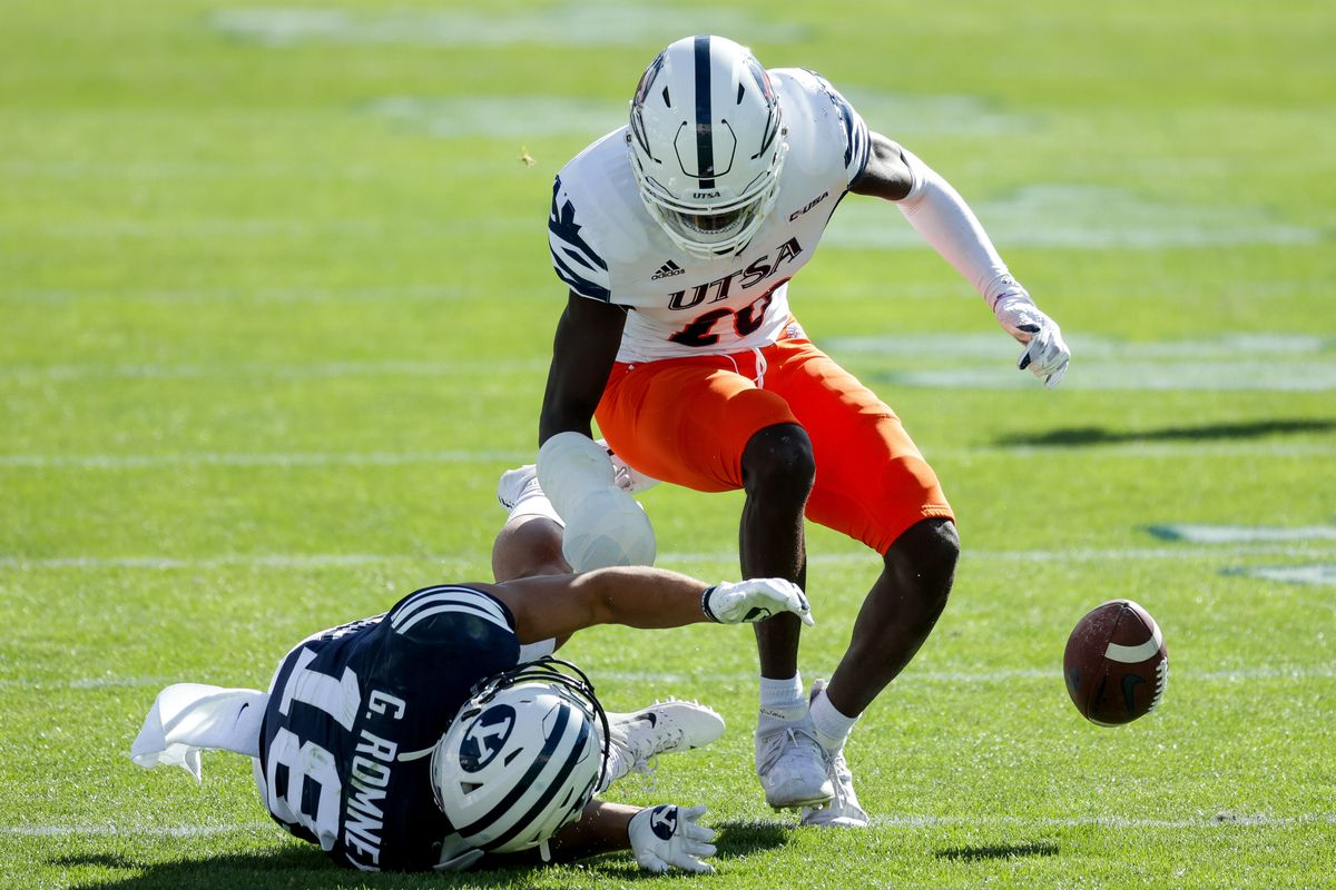 Brigham Young Cougars wide receiver Gunner Romney (18) loses his grip on a pass under pressure from UTSA Roadrunners cornerback Tariq Woolen (20) at LaVell Edwards Stadium in Provo on Saturday, Oct. 10, 2020.