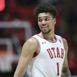 Utah Utes forward Timmy Allen (1) smiles during a time out in a game against the Oregon State Beavers in Salt Lake City on Thursday, Jan. 2, 2020. Utah won 81-69.