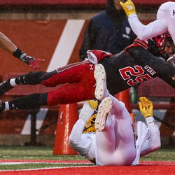 Utah Utes wide receiver Jaylen Dixon (25) dives for the first Utah touchdown during the first half of an NCAA football game at Rice-Eccles Stadium in Salt Lake City on Saturday, Oct. 19, 2019.