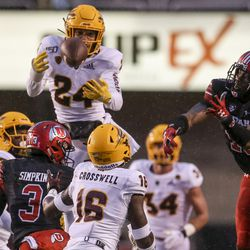 Arizona State Sun Devils defensive back Chase Lucas (24) tries to reel in a tipped ball that was batted away by Utah Utes wide receiver Donte Banton (13) during the second half of an NCAA football game at Rice-Eccles Stadium in Salt Lake City on Saturday, Oct. 19, 2019.