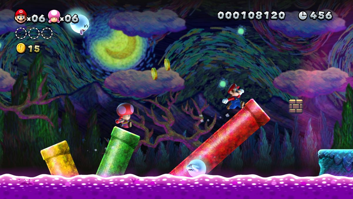 Mario and Toadette run through a spooky level in New Super Mario Bros. U Deluxe for Nintendo Switch