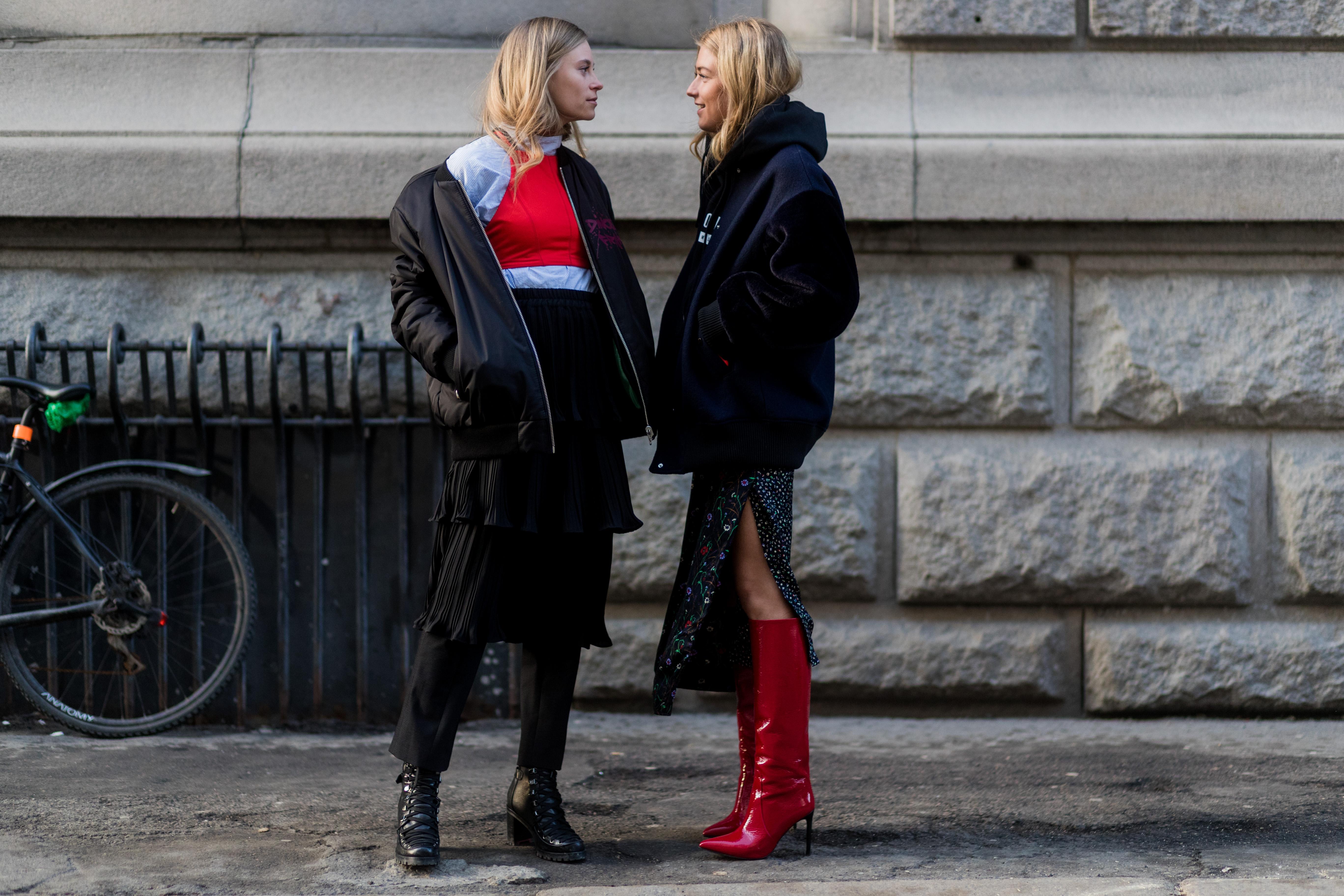 Two women wearing a bunch of layers