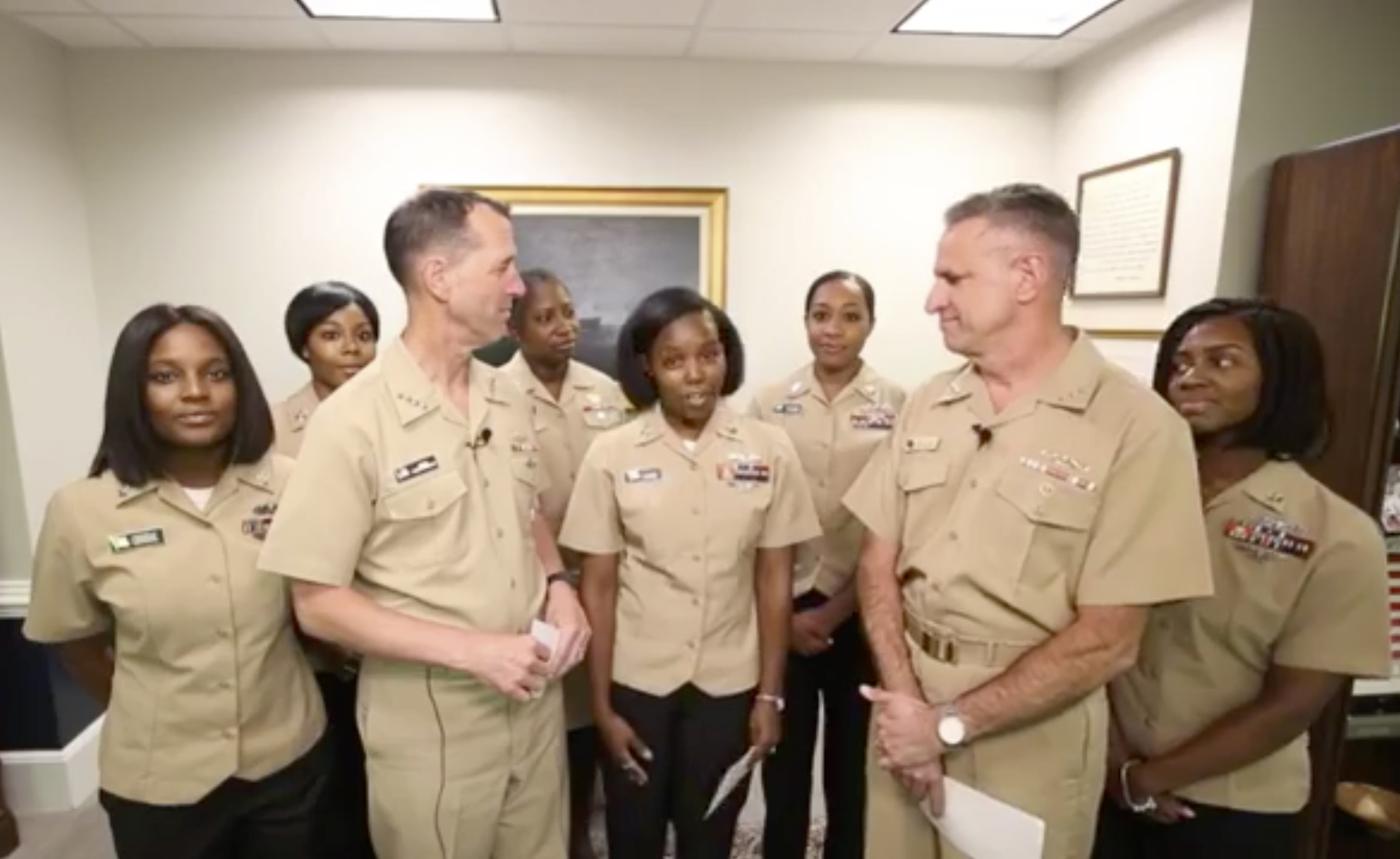 Yeoman First Class LaToya Jones, center, speaks as Chief of Naval Operations Adm. John Richardson, left of center, and Chief of Naval Personnel Adm. Robert Burke, right of center, and other members of a Navy working group.
