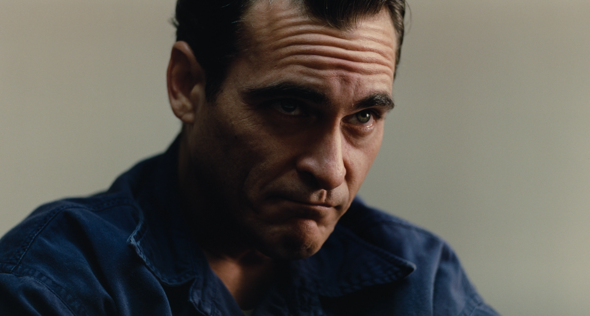Joaquin Phoenix as Freddie Quell in The Master