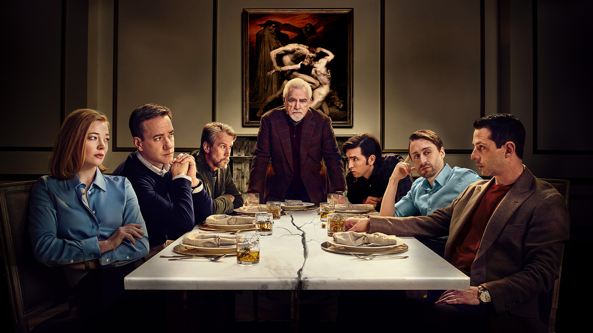 Succession's Shiv, Tom, Connor, Greg, Roman, and Kendall seated around a table, with Logan at the head of the table.