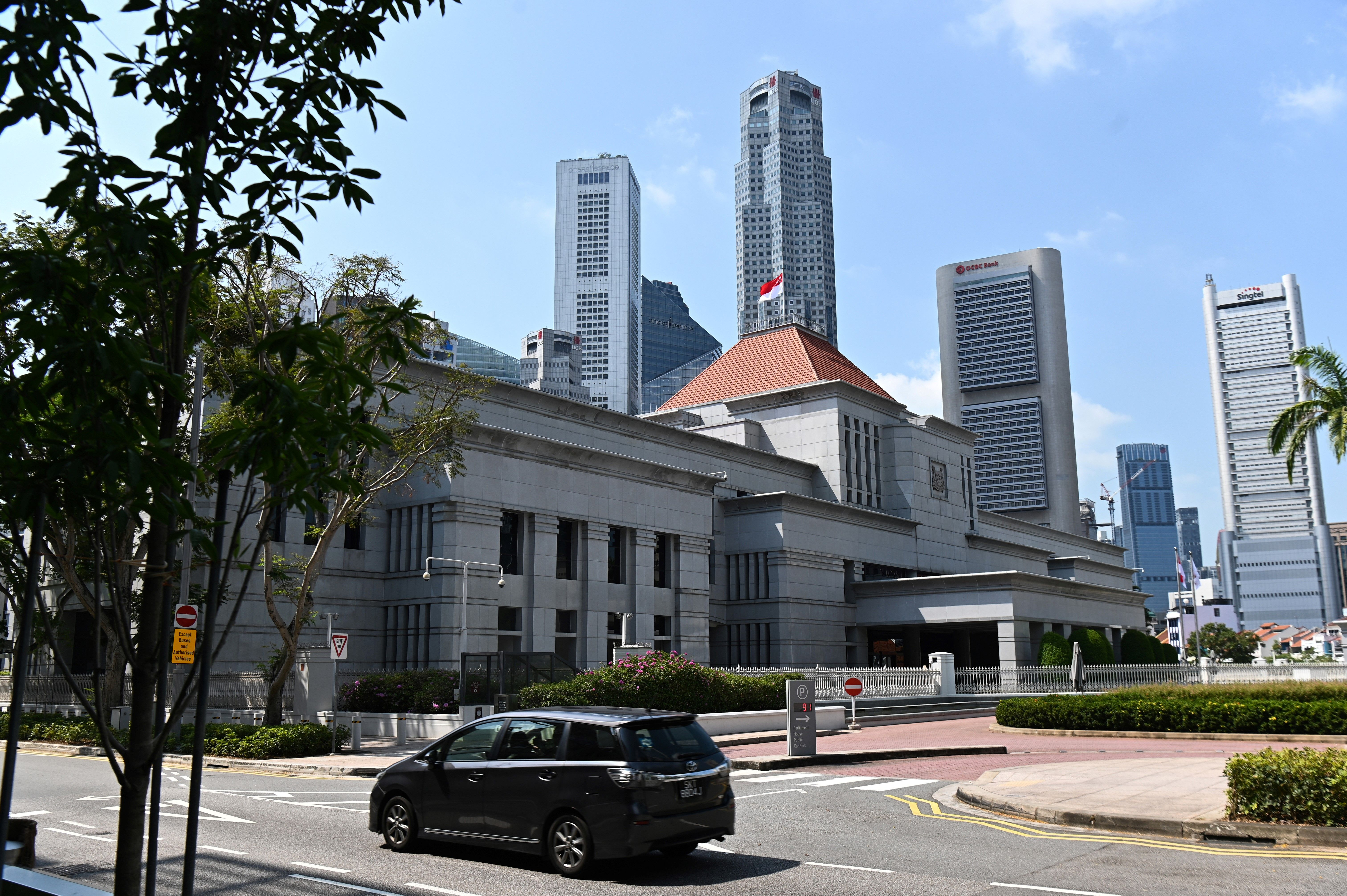 The national flag flying on the roof of the Parliament House in Singapore