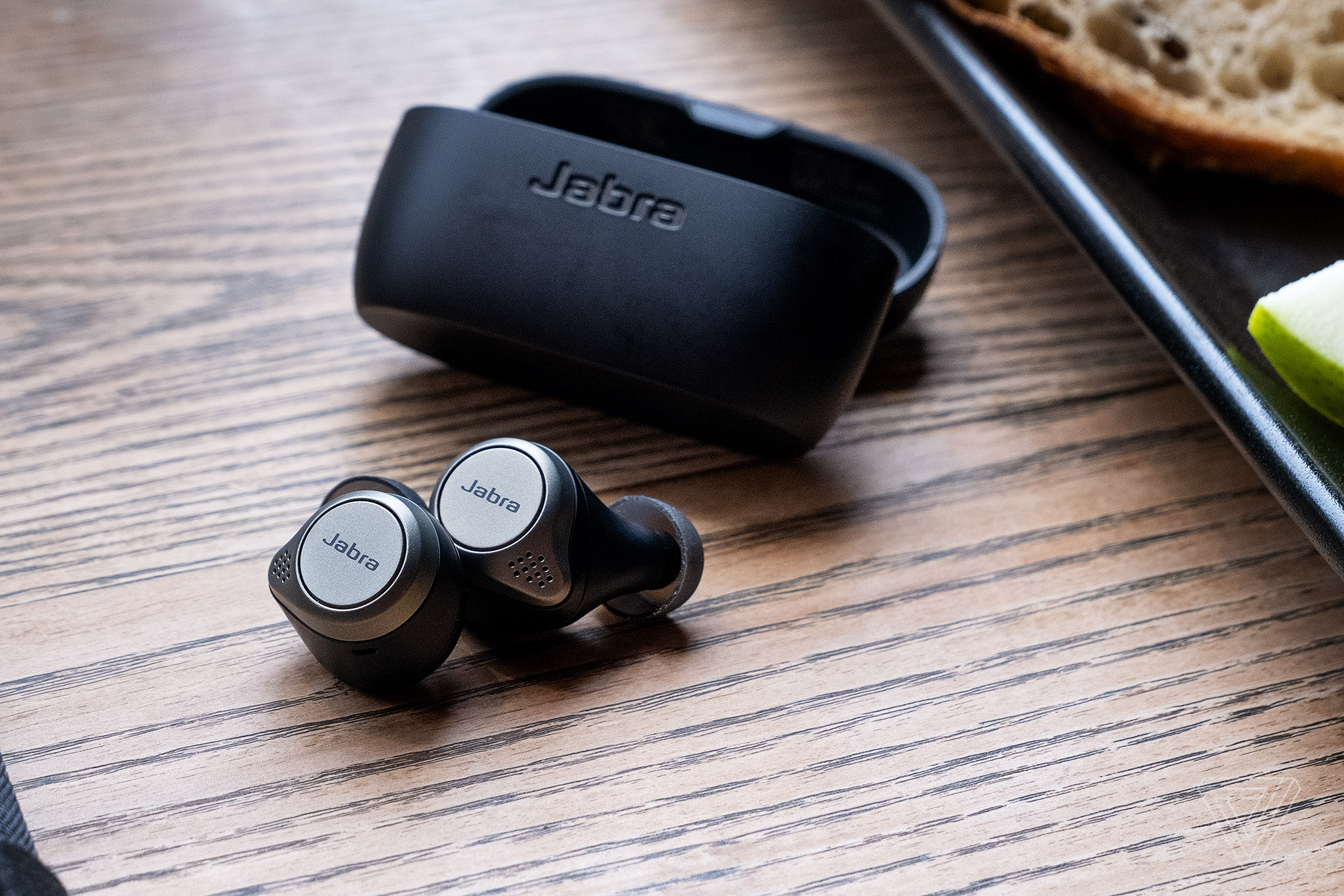 Jabra's Elite 75t, the best wireless earbuds for multitasking, pictured on a table.