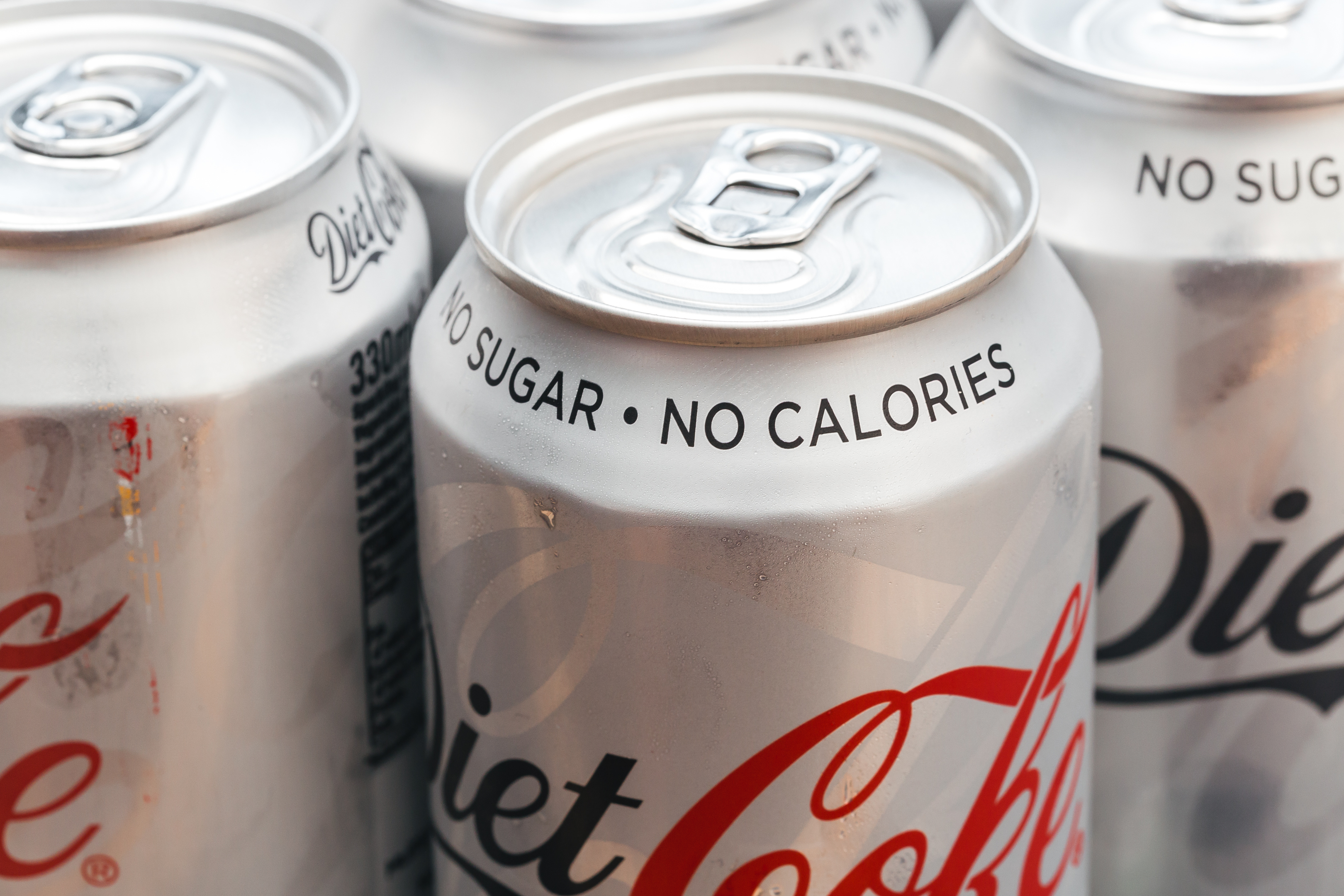 Close-up of multiple Diet Coke cans.