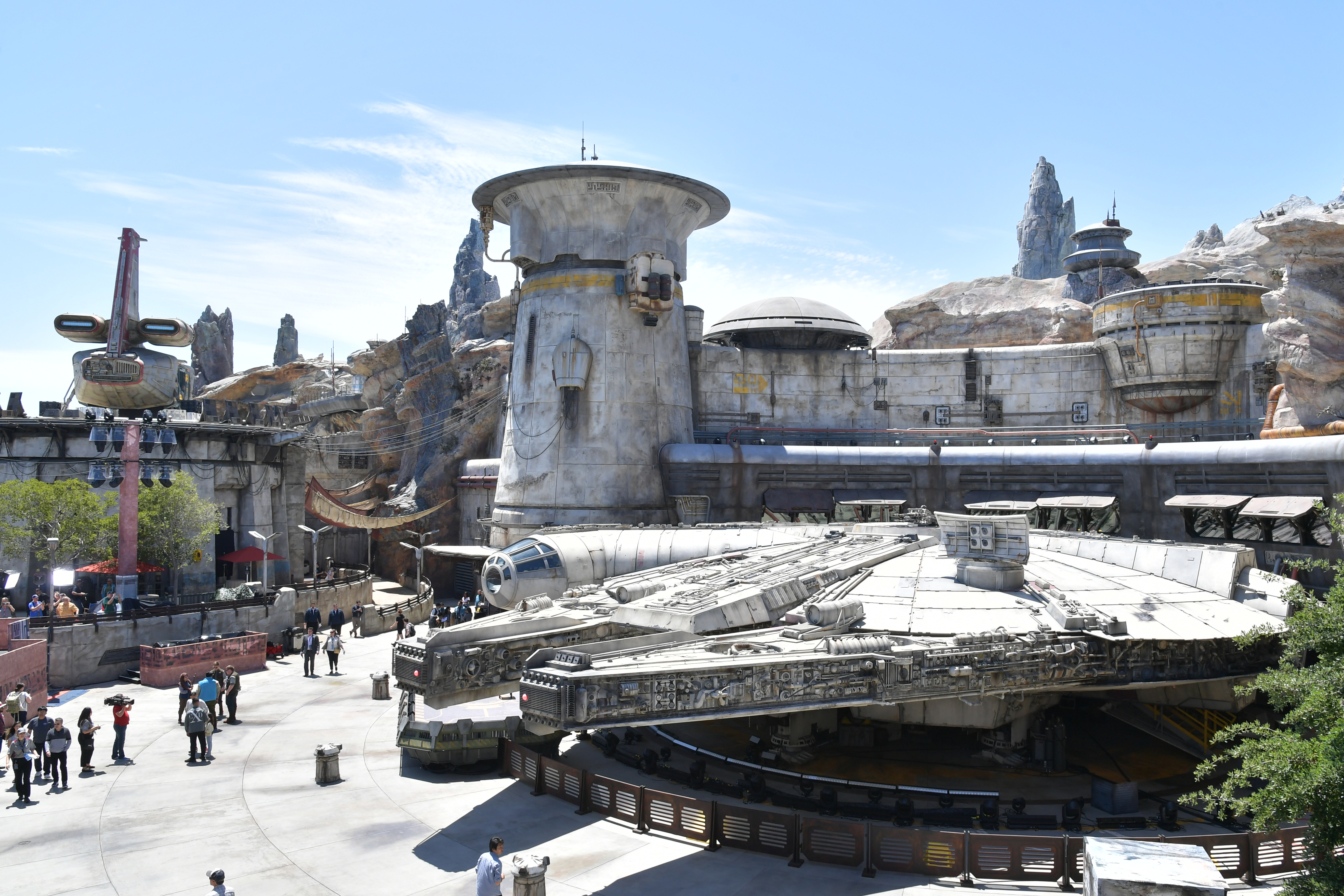 """A large scale replica of the Millennium Falcon from the """"Star Wars"""" movies sits in a large open area of the Disneyland theme park"""
