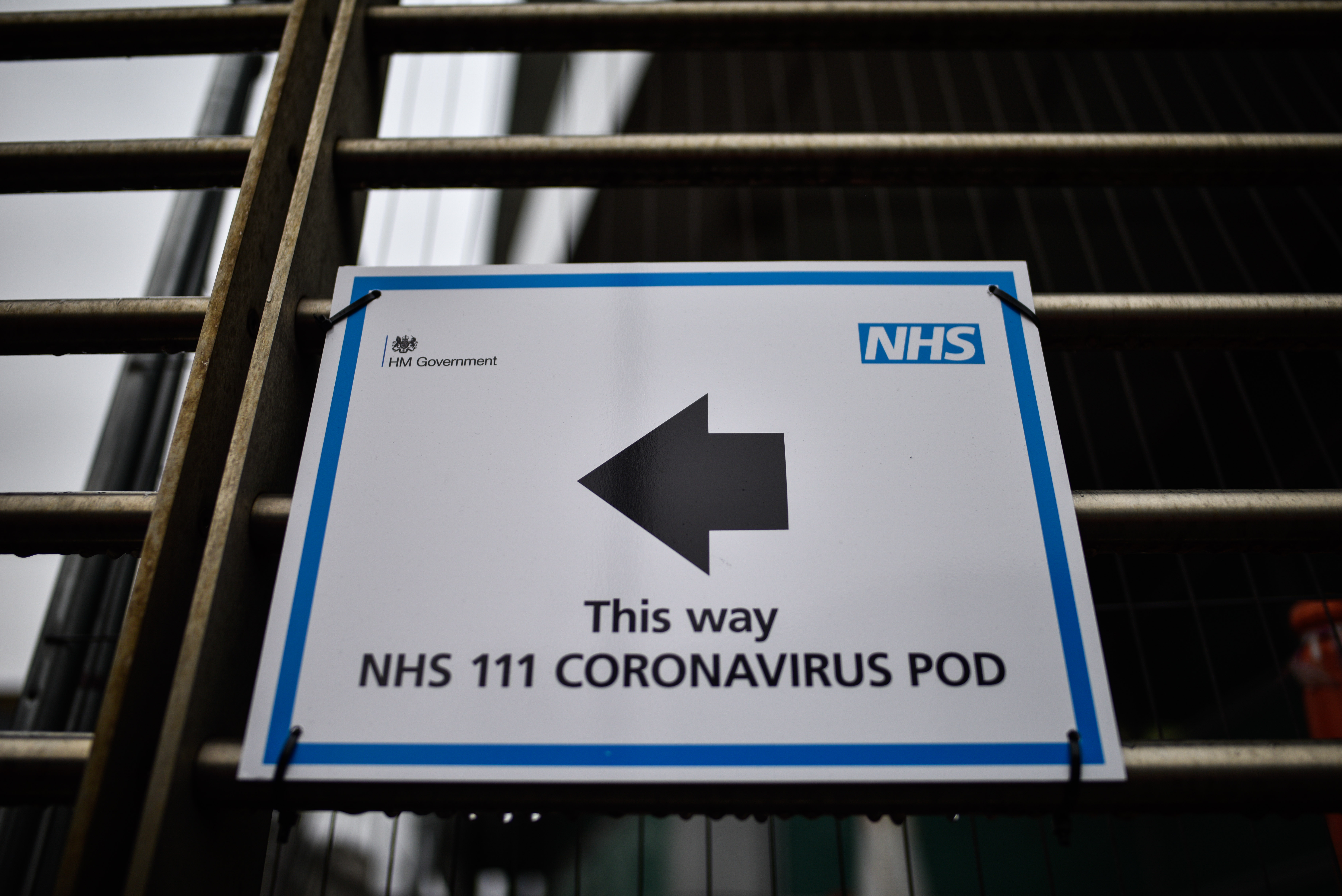 A sign directing patients towards a Coronavirus pod at University College Hospital on March 4, 2020 in London, United Kingdom.