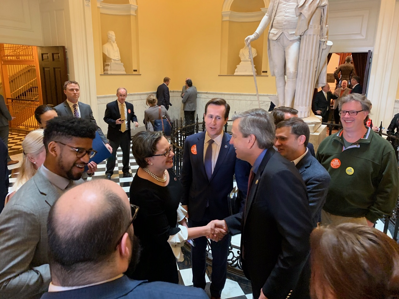 State Sen. Jennifer McClellan and Del. Rip Sullivan, the patrons of Virginia's energy bill, celebrate its passage.