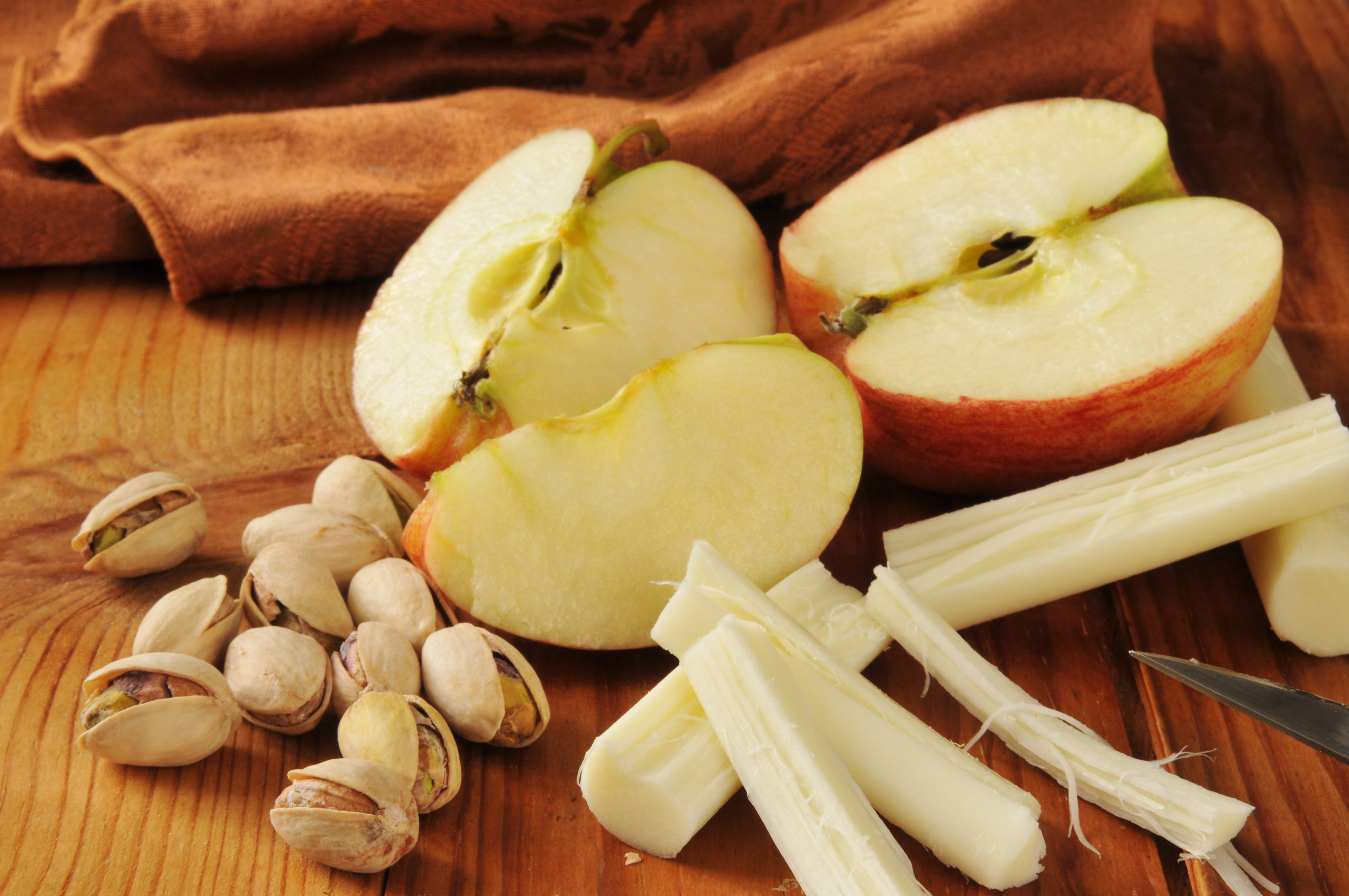 snack with pistachio nuts, apples and string cheese