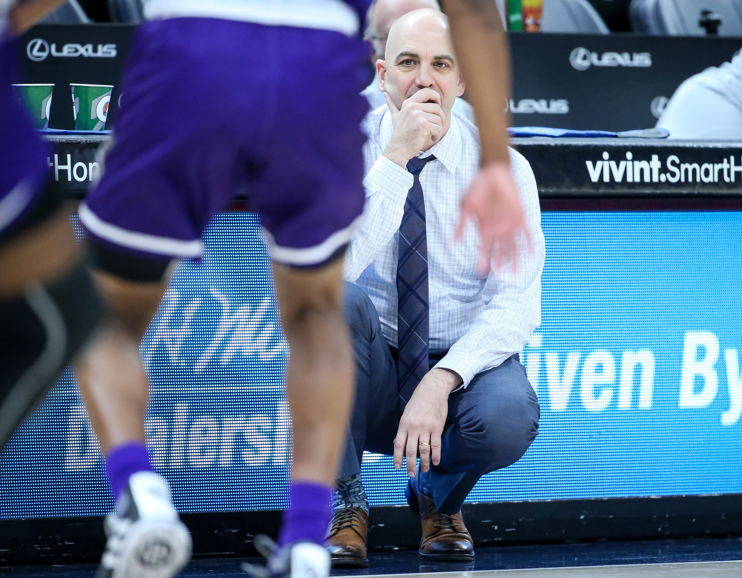 Utah State Aggies head coach Craig Smith watches action from the floor during the game against the Weber State Wildcats at Vivint Arena in Salt Lake City on Saturday, Dec. 8, 2018.