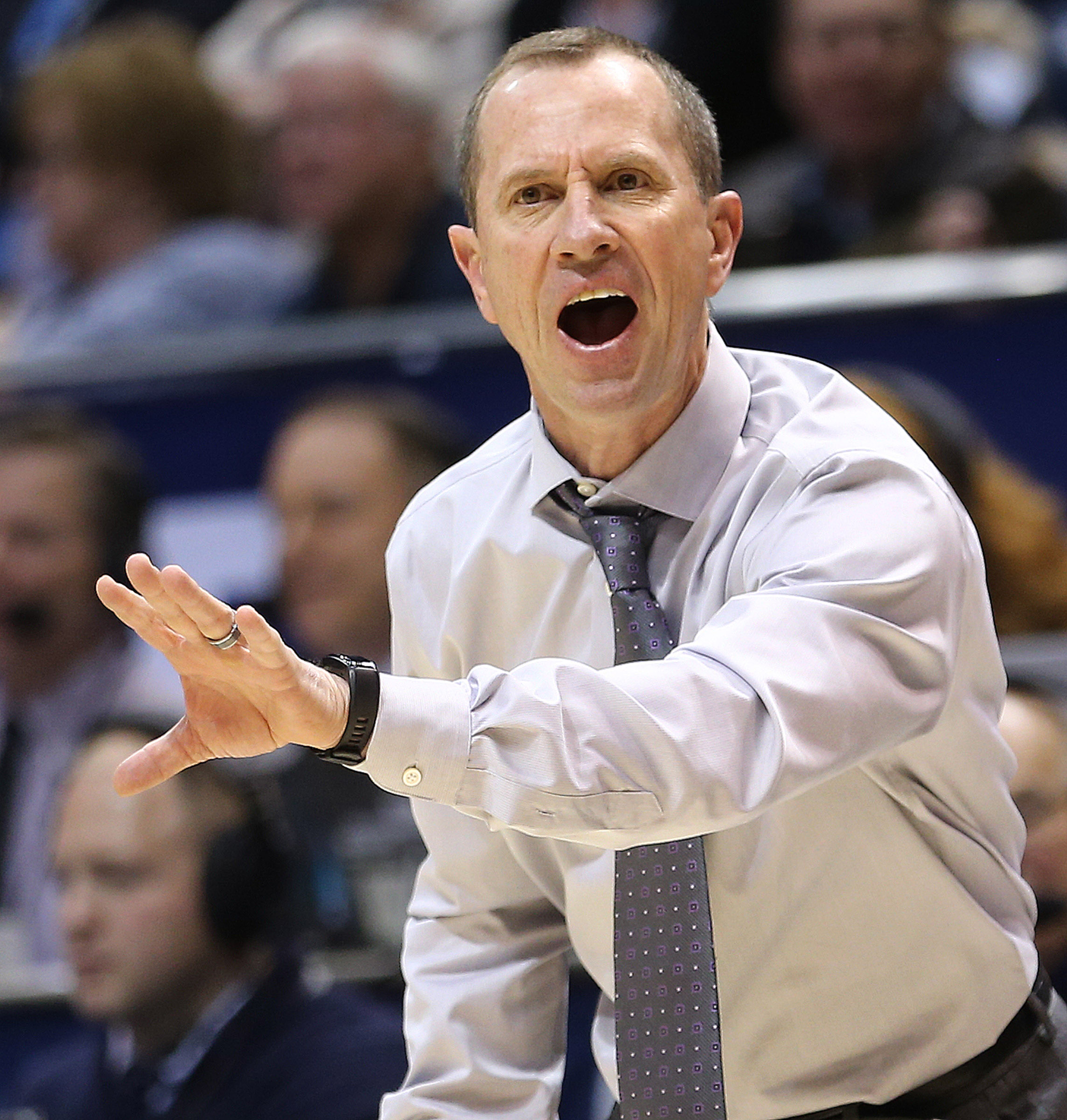 FILE — Weber State Wildcats head coach Randy Rahe calls out to his players as BYU and Weber State play at the Marriott Center in Provo on Wednesday, Dec. 7, 2016.
