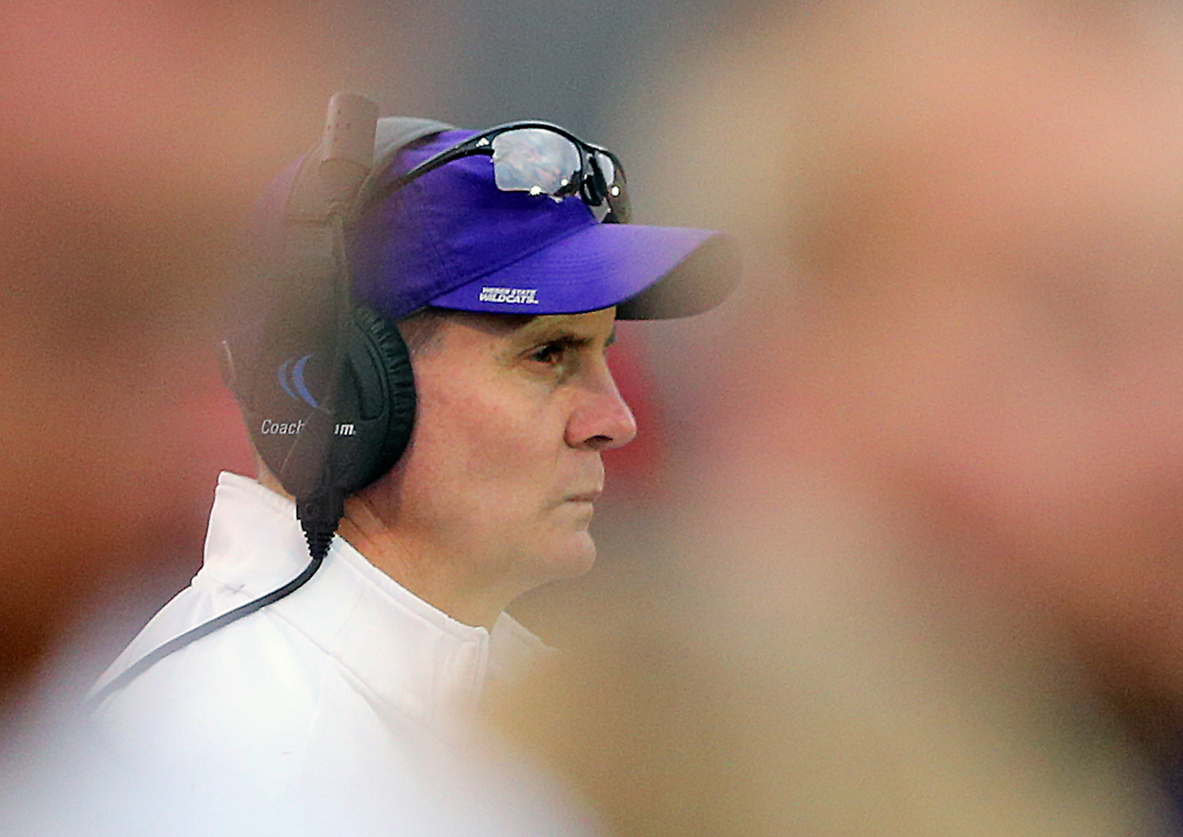Weber State Wildcats football coach Jay Hill watches from the sideline as Weber State plays Western Illinois at Stewart Stadium in Ogden Utah on Saturday, Nov. 25, 2017. Weber State won 21-19.