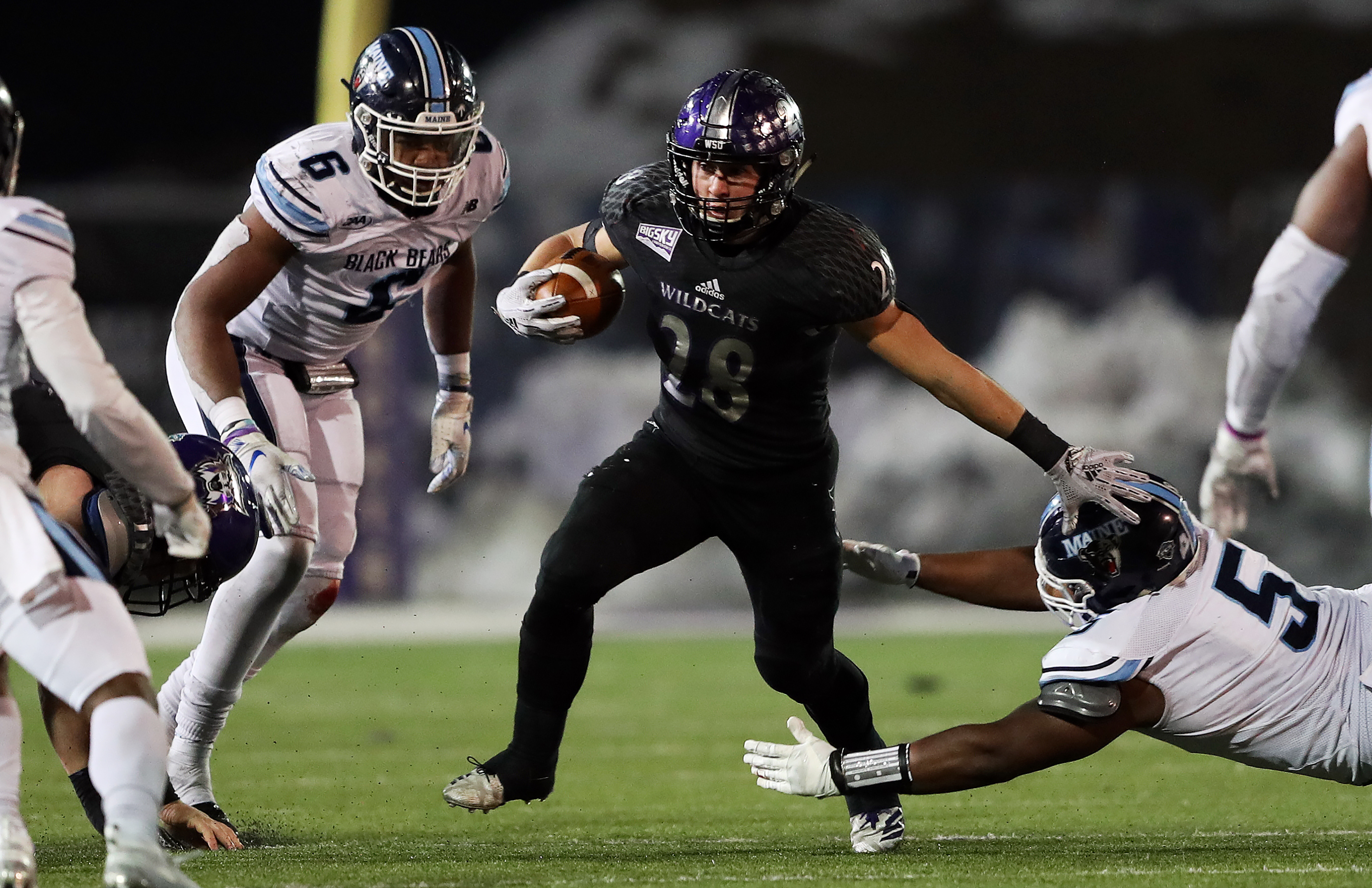 Weber State Wildcats running back Josh Davis (28) looks for running room as Weber State and Maine play in FCS quarterfinal football action in Ogden on Friday, Dec. 7, 2018. Maine won 23-18.