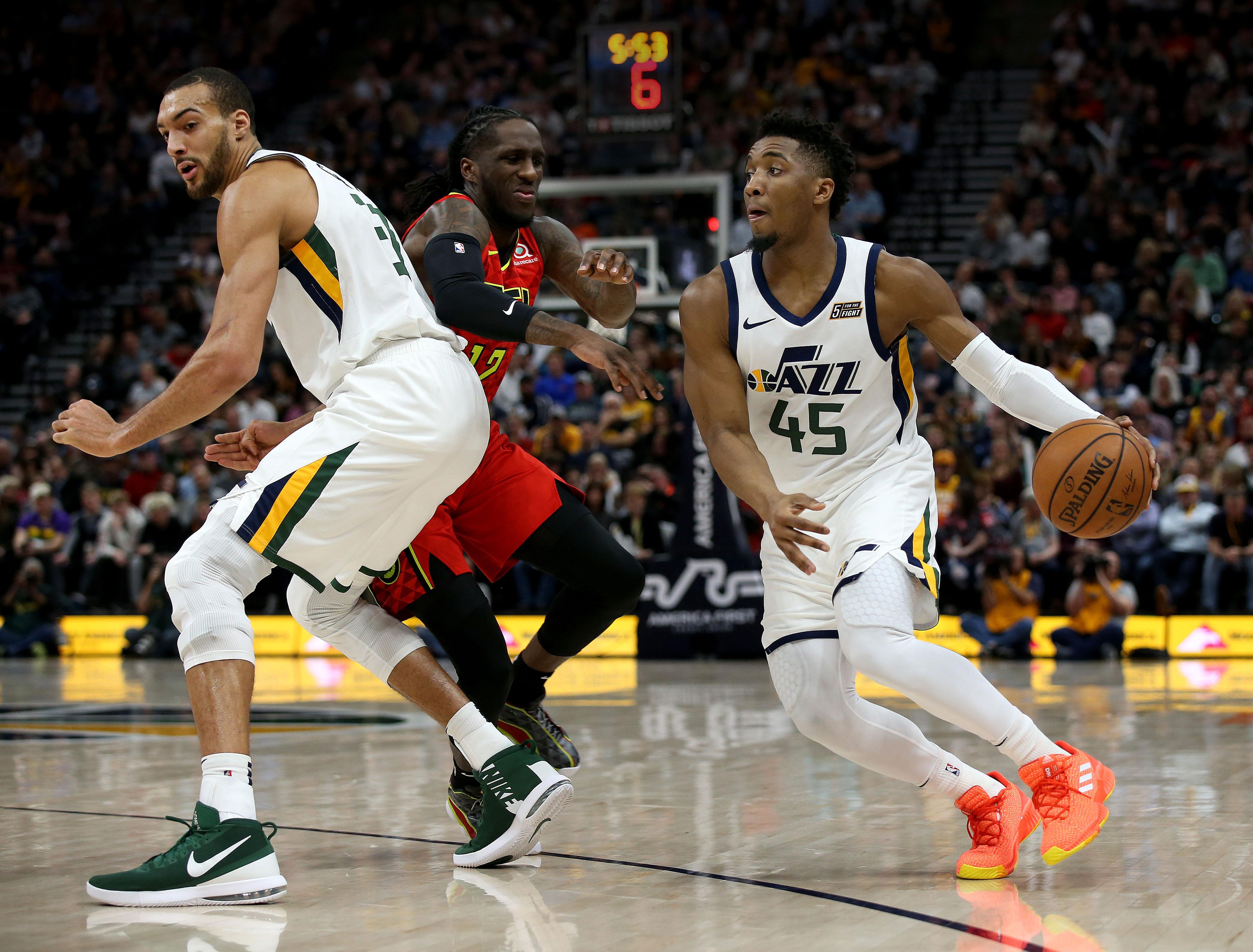 Utah Jazz center Rudy Gobert (27) blocks Atlanta Hawks forward Taurean Prince (12) for Utah Jazz Donovan Mitchell (45) at Vivint Smart Home Arena in Salt Lake City on Friday, Feb.1, 2019.