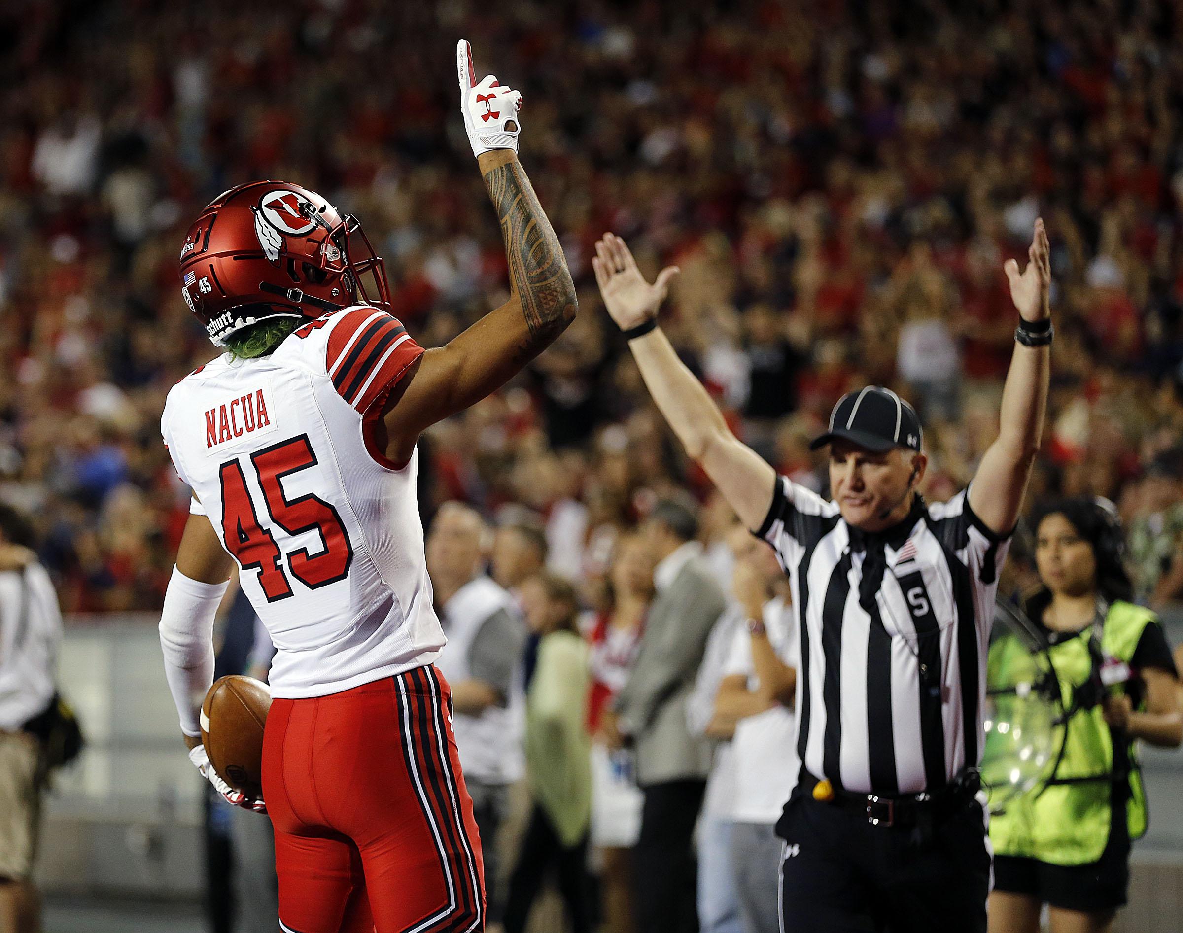 Utah wide receiver Samson Nacua celebrates a touchdown against Arizona in Tucson on Friday, Sept. 22, 2017.