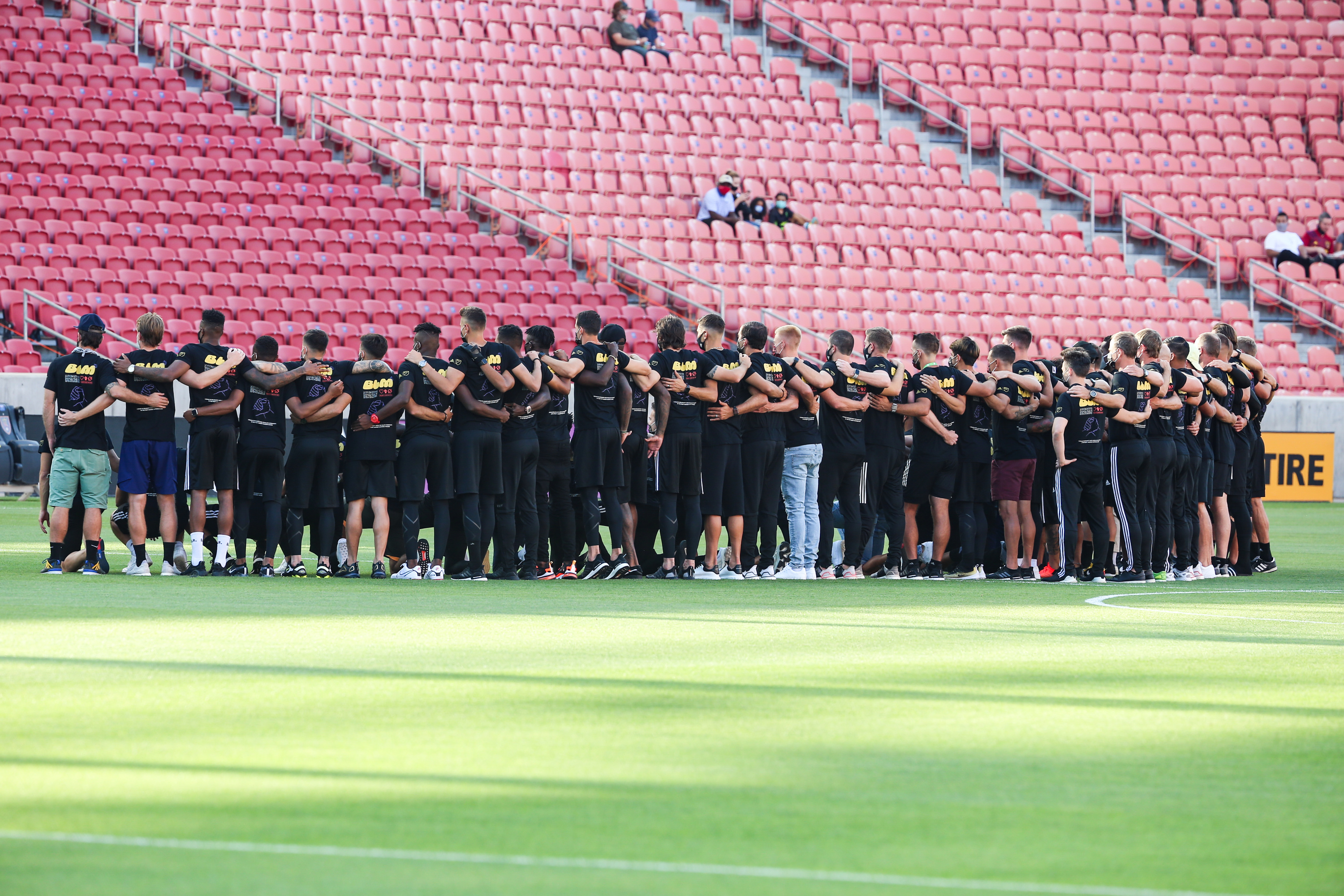 Real Salt Lake and Los Angeles FC players huddle for a group photo at Rio Tinto Stadium in Sandy on Wednesday, Aug. 26, 2020. The game was officially postponed to protest the police shooting of Jacob Blake in Wisconsin.